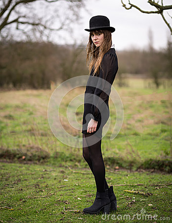 Free Beautiful Young Woman Dressed In Black Wearing Bowler Hat Stock Image - 42879311