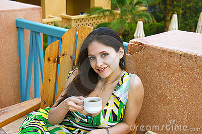 Beautiful young woman drinking coffee outdoor