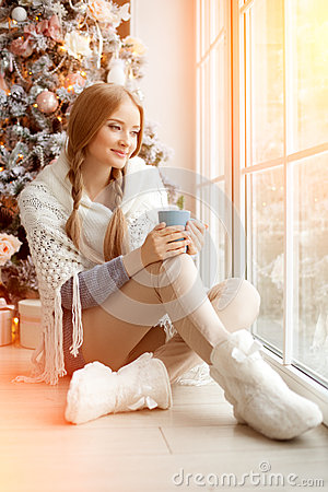 Free Beautiful Young Woman Drinking Tea At The Christmas Tree. Beauti Royalty Free Stock Images - 43538889