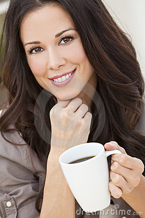 Beautiful Young Woman Drinking Tea or Coffee