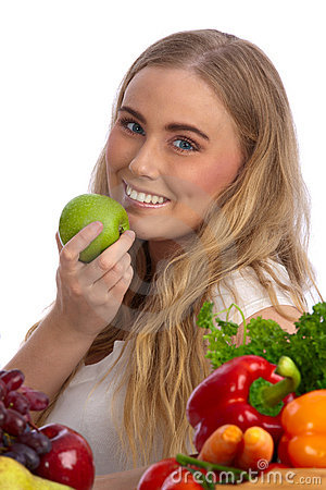 Beautiful young woman eating green apple