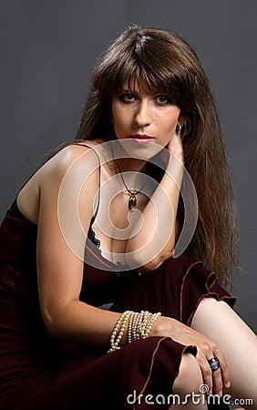 Beautiful young woman in elegance dress