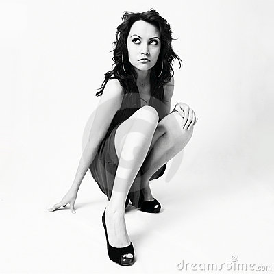 Beautiful young woman in elegant shoes
