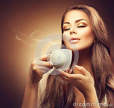 Free Beautiful Young Woman Enjoying Coffee Royalty Free Stock Photos - 62391638