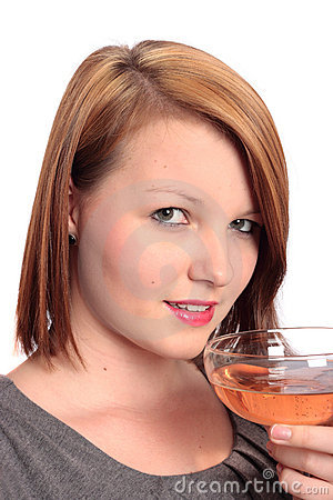 Beautiful young woman enjoying a glass of bubbly