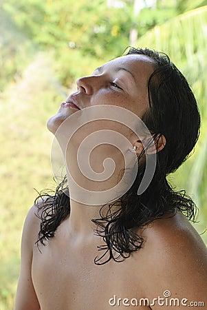 Beautiful young woman exhaling smoke