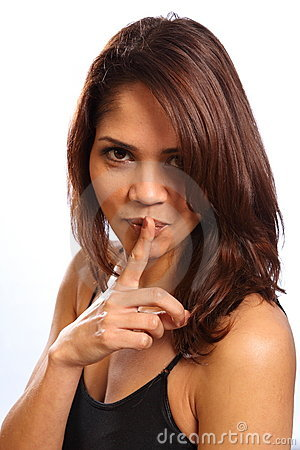 Beautiful young woman finger on lips for secret