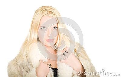 Beautiful young woman in fur coat
