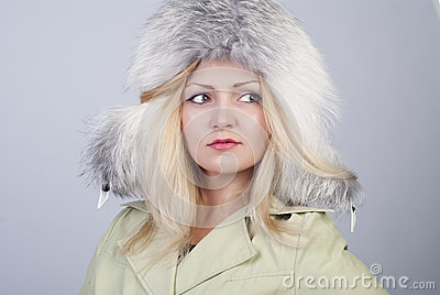 Beautiful young woman in fur hat