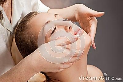 A beautiful young woman getting a massage