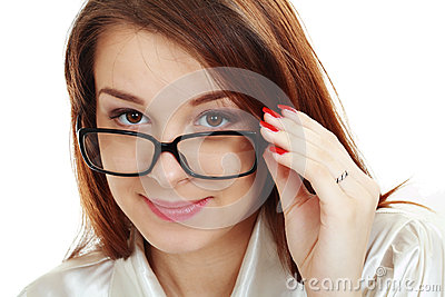 Beautiful young woman in glasses