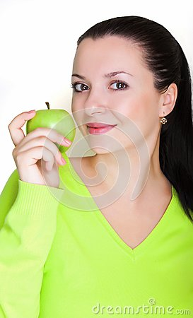 Beautiful young woman with a green apple
