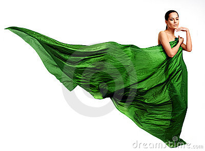 Beautiful young woman in green dress