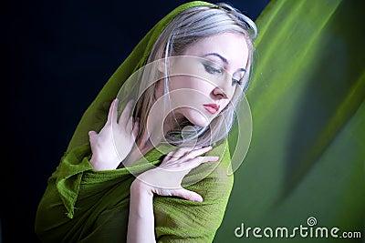 Beautiful young woman in green summer dress