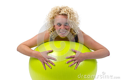 Beautiful young woman with gym ball