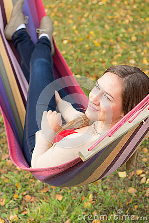 Beautiful young woman in hammock