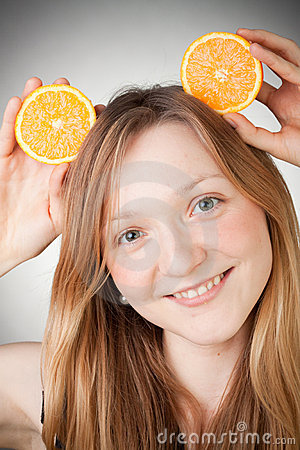 Beautiful young woman has orange ears