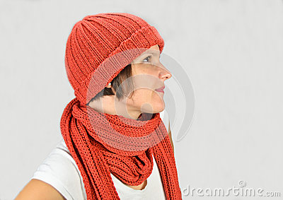 A beautiful young woman with a hat and a scarf