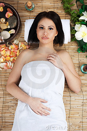 Beautiful young woman in health spa