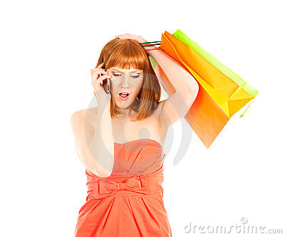 Beautiful young woman with her shopping bags