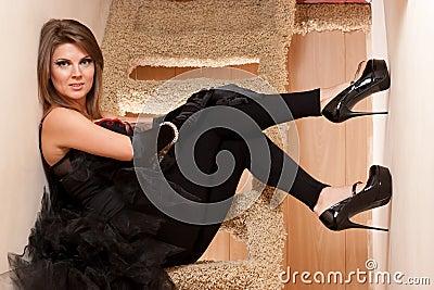 Beautiful young woman in high heels shoes