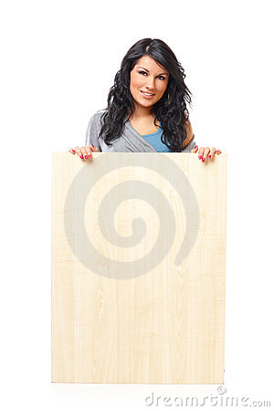 Beautiful young woman holding a blank wooden board
