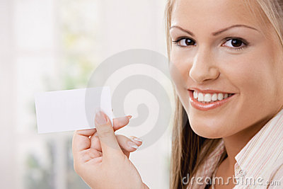 Beautiful young woman holding card