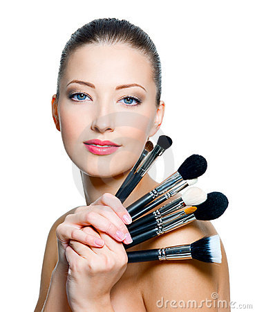 Beautiful young  woman  holding make-up brushes