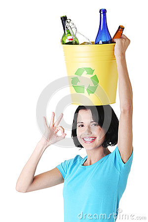 Beautiful young woman holding recycling basket