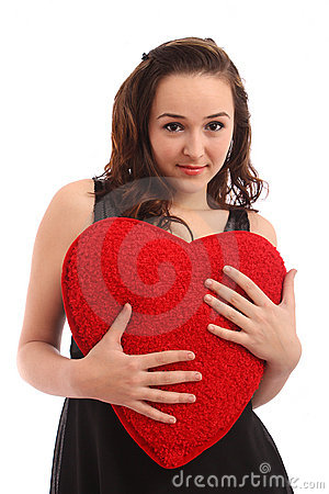 Beautiful young woman holding red heart