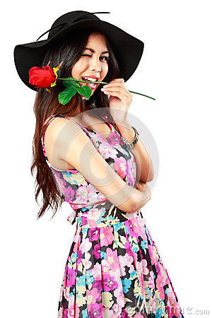 Beautiful young woman holding a red rose