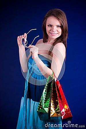 Beautiful young woman holding shopping bags