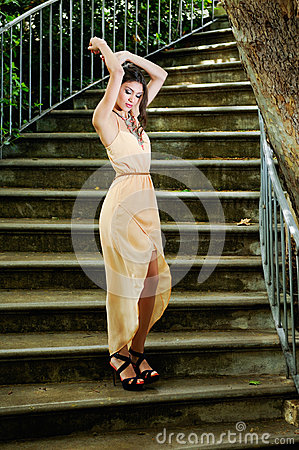 Free Beautiful Young Woman In A Garden Stairs. Royalty Free Stock Images - 36479719