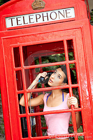 Free Beautiful Young Woman In Phone Booth Stock Image - 20318961