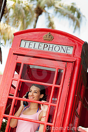 Free Beautiful Young Woman In Telephone Booth Royalty Free Stock Image - 20783556
