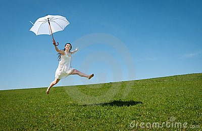 Beautiful young woman jumping with white umbrella