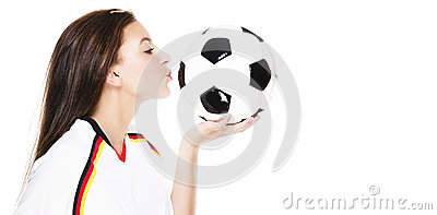 Beautiful young woman kissing a football