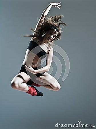 Beautiful young woman leap jump