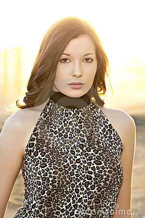 Beautiful young woman in leopard print top