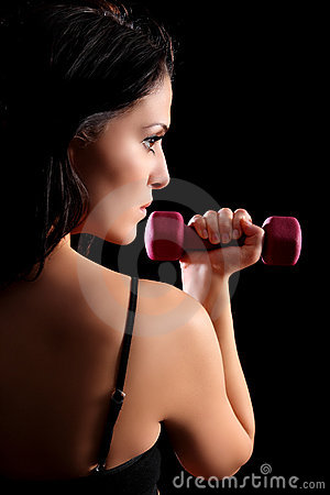 Beautiful young woman lifting fitness weights