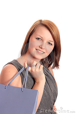 Beautiful young woman with lilac shopping bag