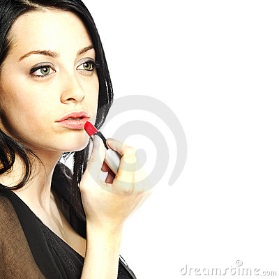 Beautiful young woman with lipstick in her hand