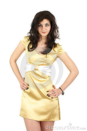 Beautiful young woman in little yellow silk dress