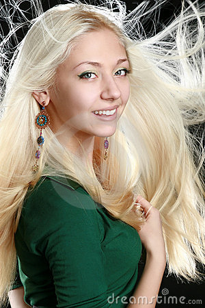 Beautiful young woman with long blond hair