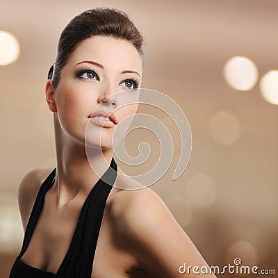 Beautiful young woman lookin away