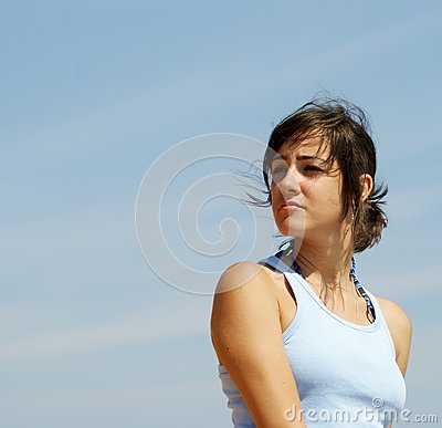 Beautiful young woman looking in the distance