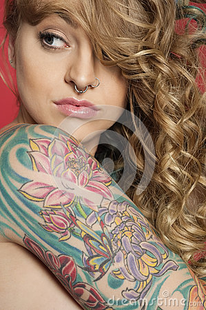 arm sideways looking young tattooed woman