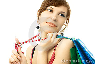 Beautiful young woman with a lot of shopping bags