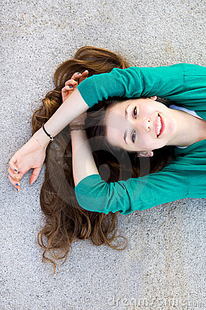 Beautiful young woman lying down