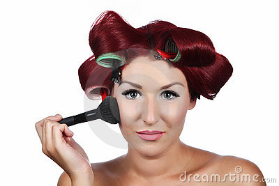Beautiful Young Woman with a make-up brush